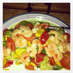 Shrimp Salad with mango, avocado, red pepper, onion, and tomatoes over spinach with a fresh lime, lemon, olive oil, & balsamic vinaigrette dressing